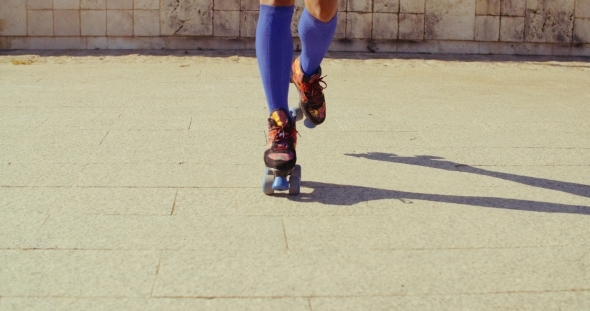 Close Up On Girls Feet While Riding Roller Skates