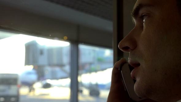 Man Having Phone Conversation At Airport