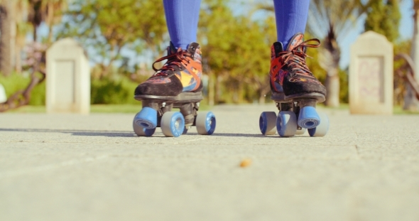 Low Angle Video Of a Girl Riding Roller Skates