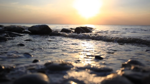 Pebble Beach And Waves During Amazing Sunset Have