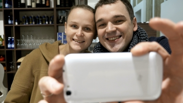 Lovely Couple In Cafe Making Selfie