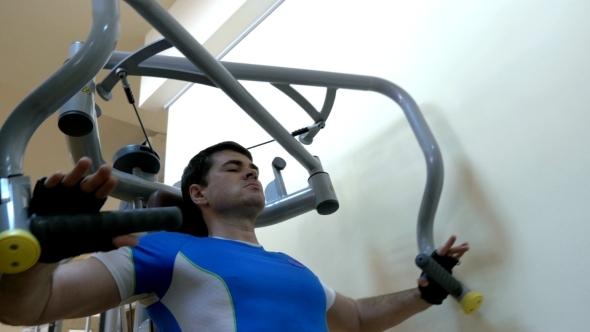Man Exercising On Chest Press Machine