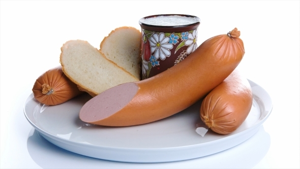 Milk Bread And Sausage On a White Background