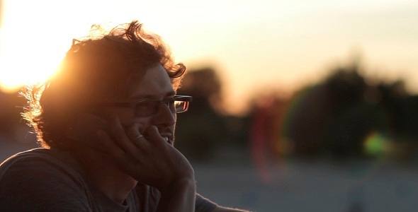 Man Talking On The Phone At Sunset