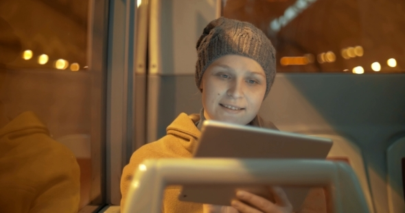Woman Traveling By Bus With Touch Pad