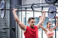 Two young Bodybuilders doing weightlifting in the crossfit gym
