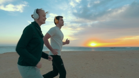 Jogging On The Beach At Sunset