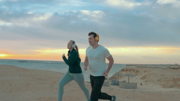 Evening Run Together On The Sea Shore