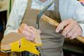 Cobbler hammering a shoe