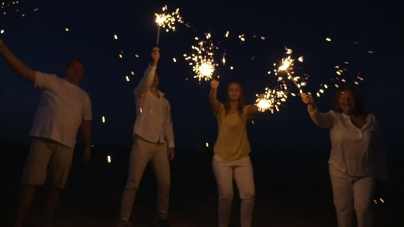 Family With Sparklers On The Beach At Night