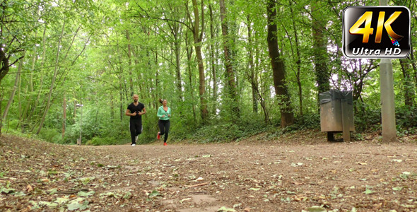 Young Couple Running in Nature