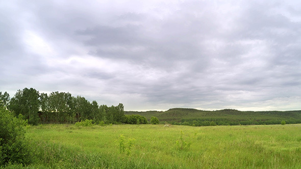 Green Meadow And Clouds