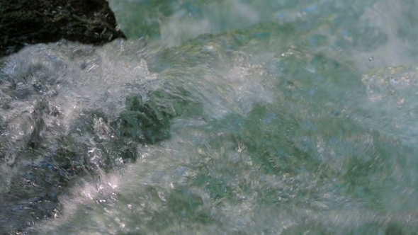 Crystal Water Of River Stream Flowing And