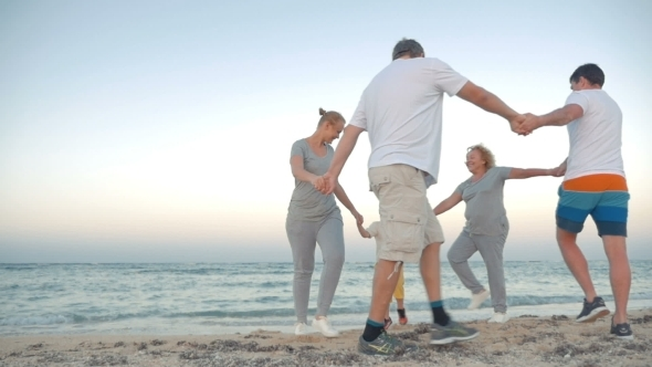 Family Circle Dancing On The Coast