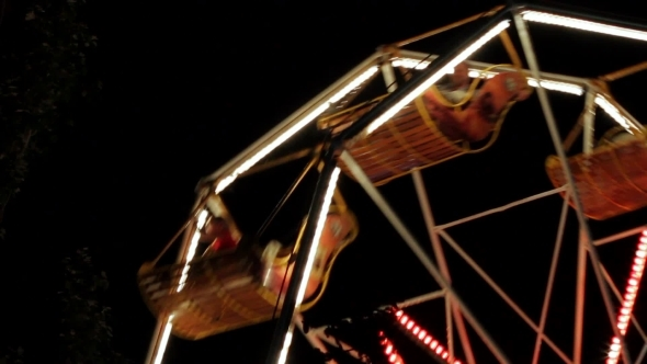 Of A Funfair Ride At Night