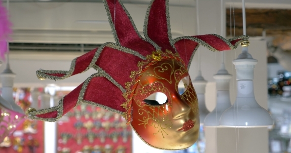 Red Venetian Mask Hanging In The Store