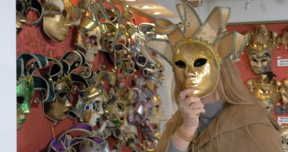 Woman In The Store Of Venetian Masks