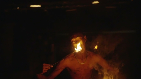 Fire Eater Performing At Night