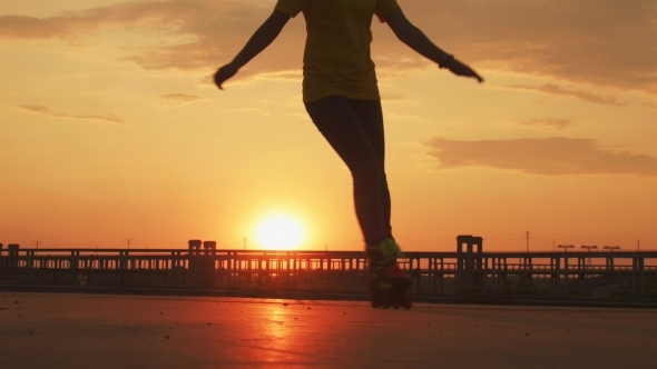 VideoHive The Girl Skates On The Bridge At Sunset 12113710