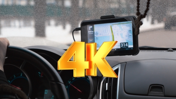 VideoHive Driving a Car With GPS Device Over Dashboard 12117874