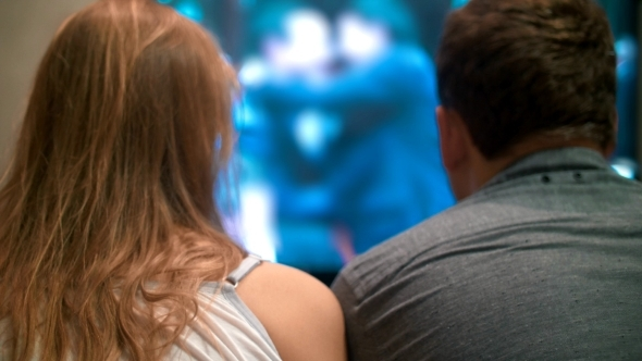 VideoHive Young Man And Woman Watching Television At Home 12130440