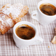 Cups of coffee with croissant