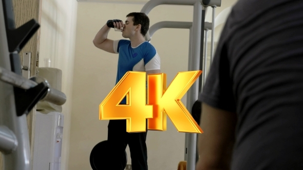 VideoHive Man Drinking Water During Break In The Gym 12152732