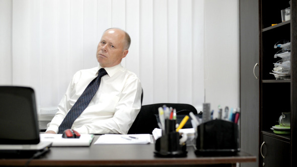 VideoHive Businessman in Office Relaxing 12153036