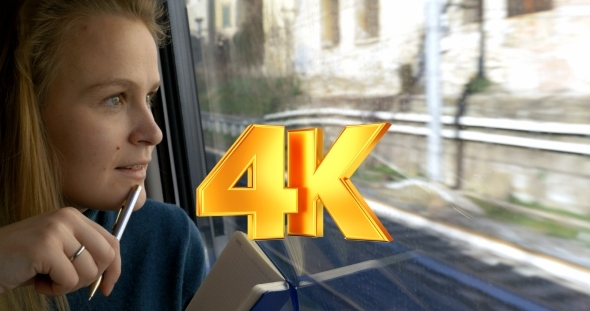 VideoHive Woman Making Sketches During Train Ride 12153095