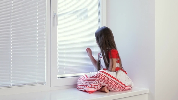VideoHive The Girl Is Sad At The Window In The Room 12153183