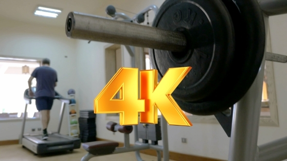 VideoHive Sportsman Putting Disk Weight On The Barbell 12153346