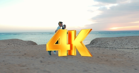 VideoHive Young People Jogging On The Beach At Sunset 12153376