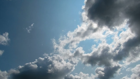 VideoHive Clouds Moving In The Blue Sky 12157548