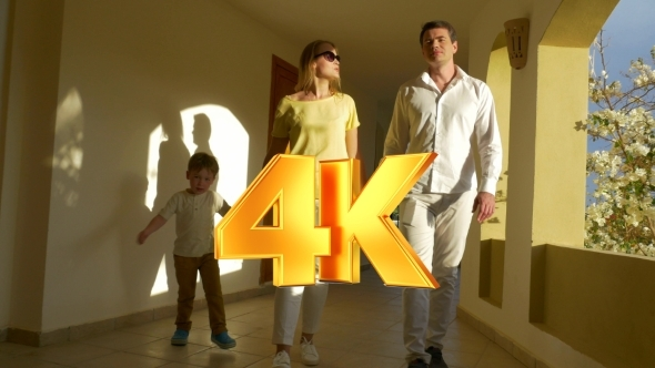 VideoHive Young Family Walking Over The Passage 12157606