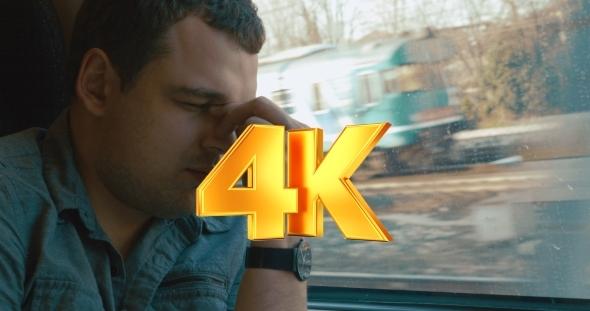 VideoHive Man Taking a Headache Pill In The Train 12157640