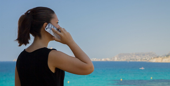 VideoHive Businesswoman talking On The Beach 12163162
