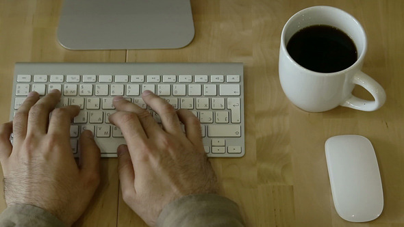 VideoHive Typing at Light Wooden Desk at Laptop 12163250