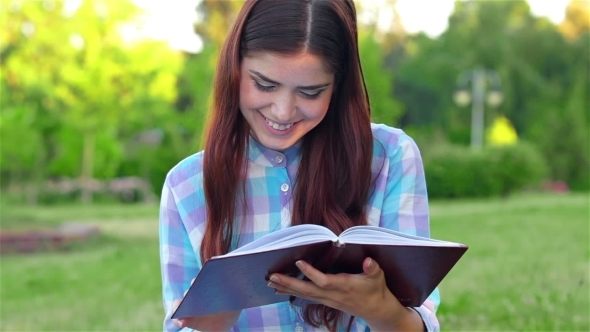 VideoHive Beautiful Girl With Book In The Park 12163984