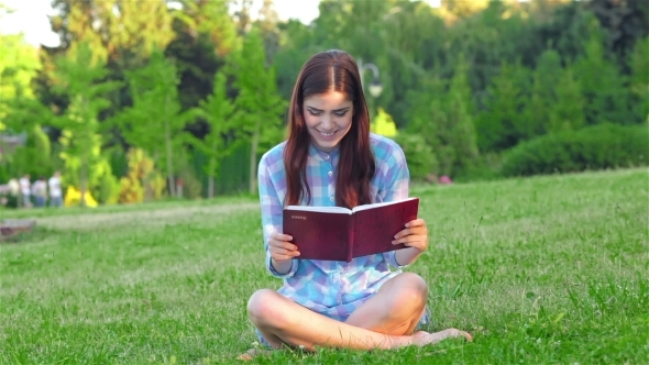 VideoHive Beautiful Girl With Book In The Park 12164029