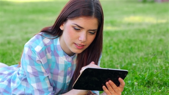 VideoHive Beautiful Smiling Girl With Touchpad Outdoors 12164297