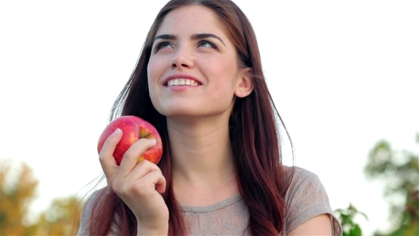 VideoHive Portrait Of Smiling Beautiful Girl With An Apple 12164339