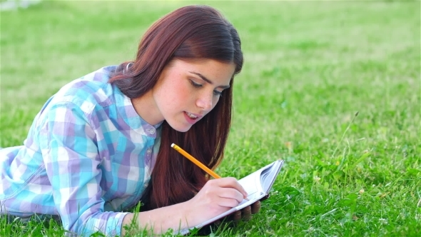 VideoHive Beautiful Girl With Her Diary In Park 12164359