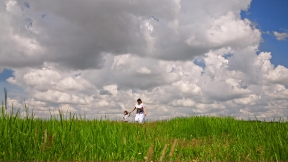 VideoHive Happy Mother And Small Son Walking In Green Field 12164725