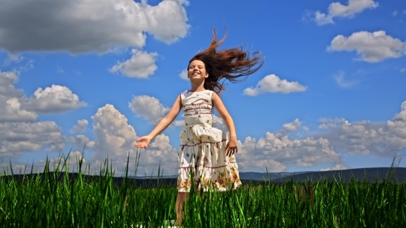 VideoHive Pretty Girl Jumping In Green Field 12164822