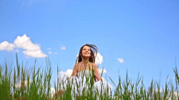 VideoHive Happy Girl Jumping In Green Field 12164893