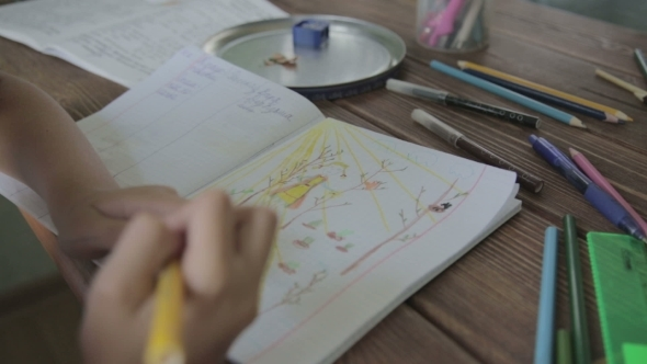 VideoHive Girl Drawing Sun On Notebook 12165741