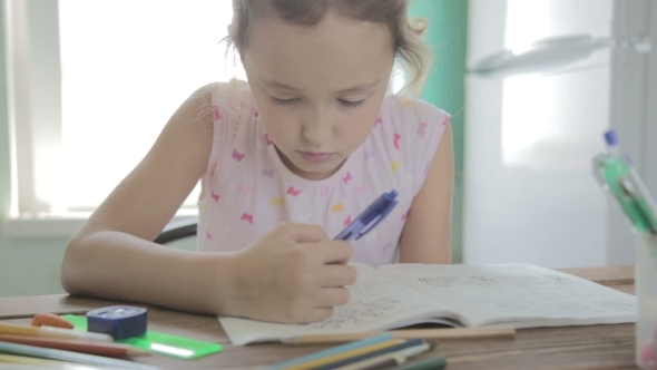 VideoHive Girl Is Doing Homework For Elementary School 12165751
