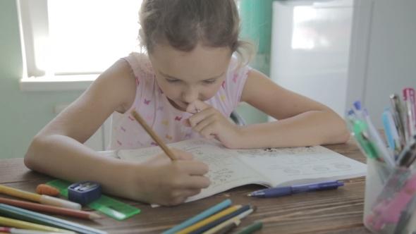 VideoHive Girl Is Doing Homework For Elementary School 12165755