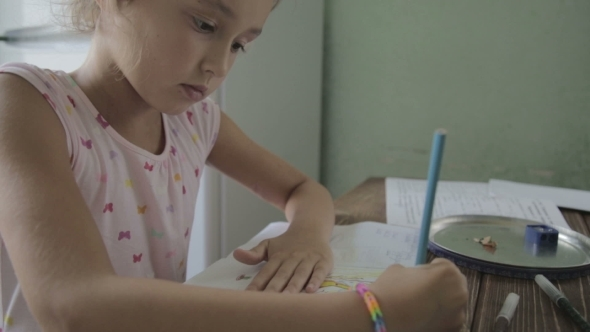 VideoHive Girl Is Doing Homework For Elementary School 12165768