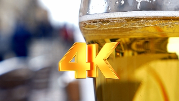 VideoHive Glass With Light Beer In Outdoor Cafe 12166083